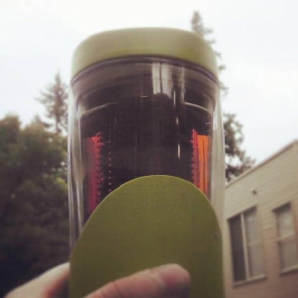 Doke in a travel mug