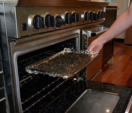 putting leaves in the oven